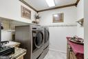 Huge laundry room on main level - 13915 MARBLESTONE DR, CLIFTON