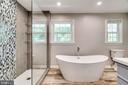 Luxury soaking tub in the master bath - 5708 GLENWOOD CT, ALEXANDRIA