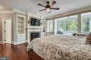 Master Bedroom w/ Built-ins & Fireplace - 6811 CLIFTON RD, CLIFTON