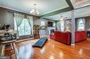 Imagine your dining table where the treadmill is - 3110 RIVERVIEW DR, COLONIAL BEACH