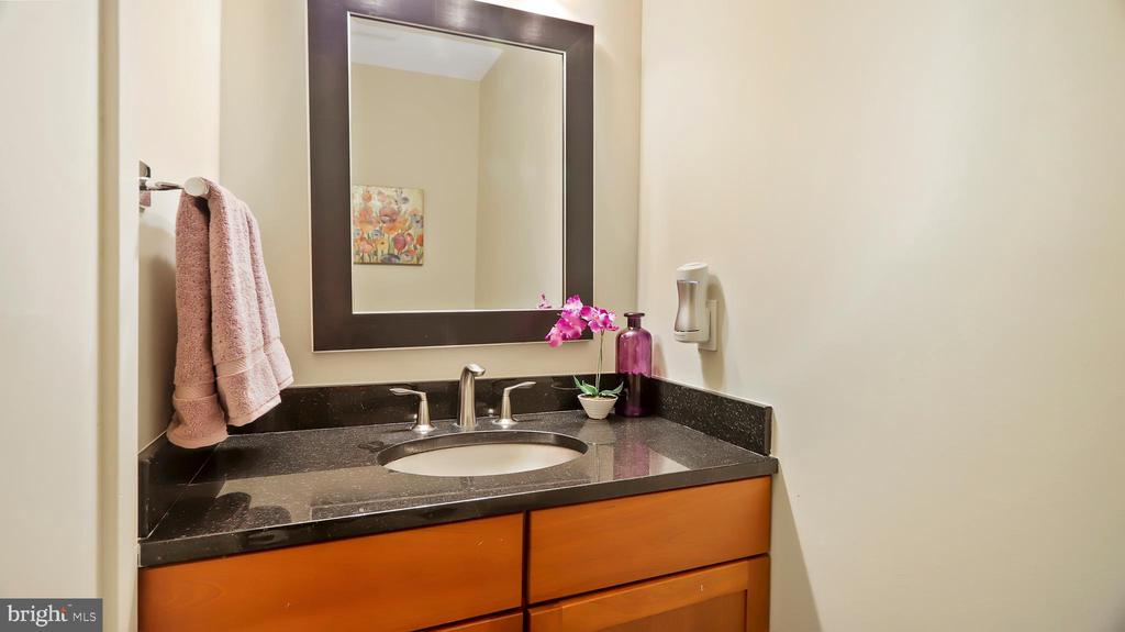 1st floor powder room - 10717 MEADOWOOD DR, VIENNA