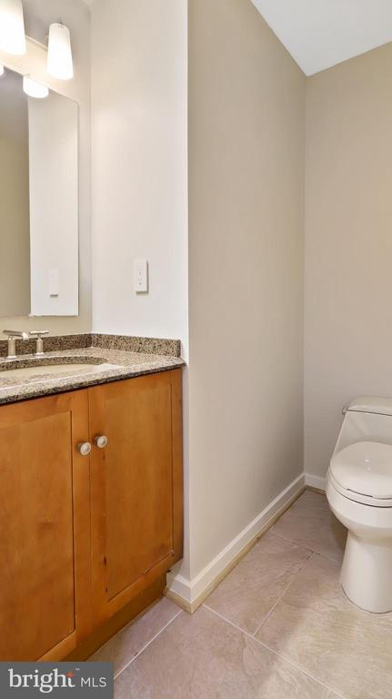 Lower powder room - 10717 MEADOWOOD DR, VIENNA
