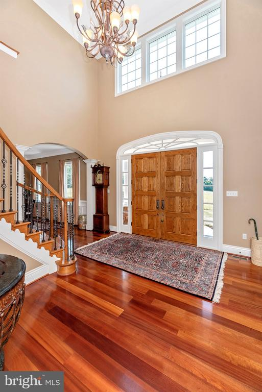 Two-story foyer with stately front door - 12788 BARNETT DR, MOUNT AIRY