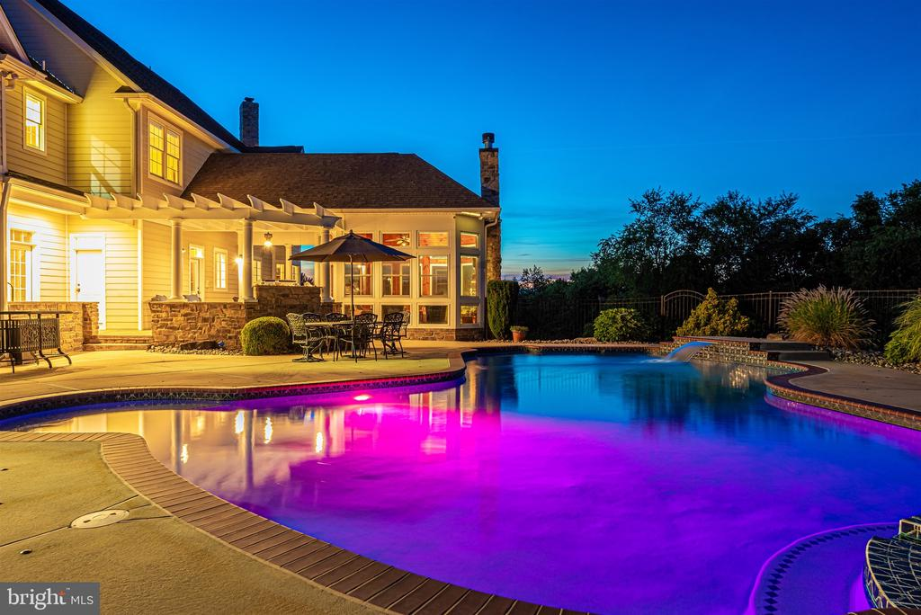 Pool lights can change colors on a whim - 12788 BARNETT DR, MOUNT AIRY