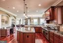 Expansive kitchen island with built-in fridge - 12788 BARNETT DR, MOUNT AIRY