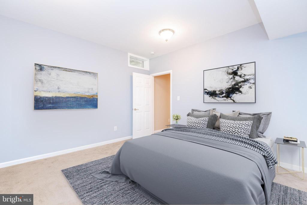 Basement bedroom with carpeting and ample light - 6033 SUMNER RD, ALEXANDRIA
