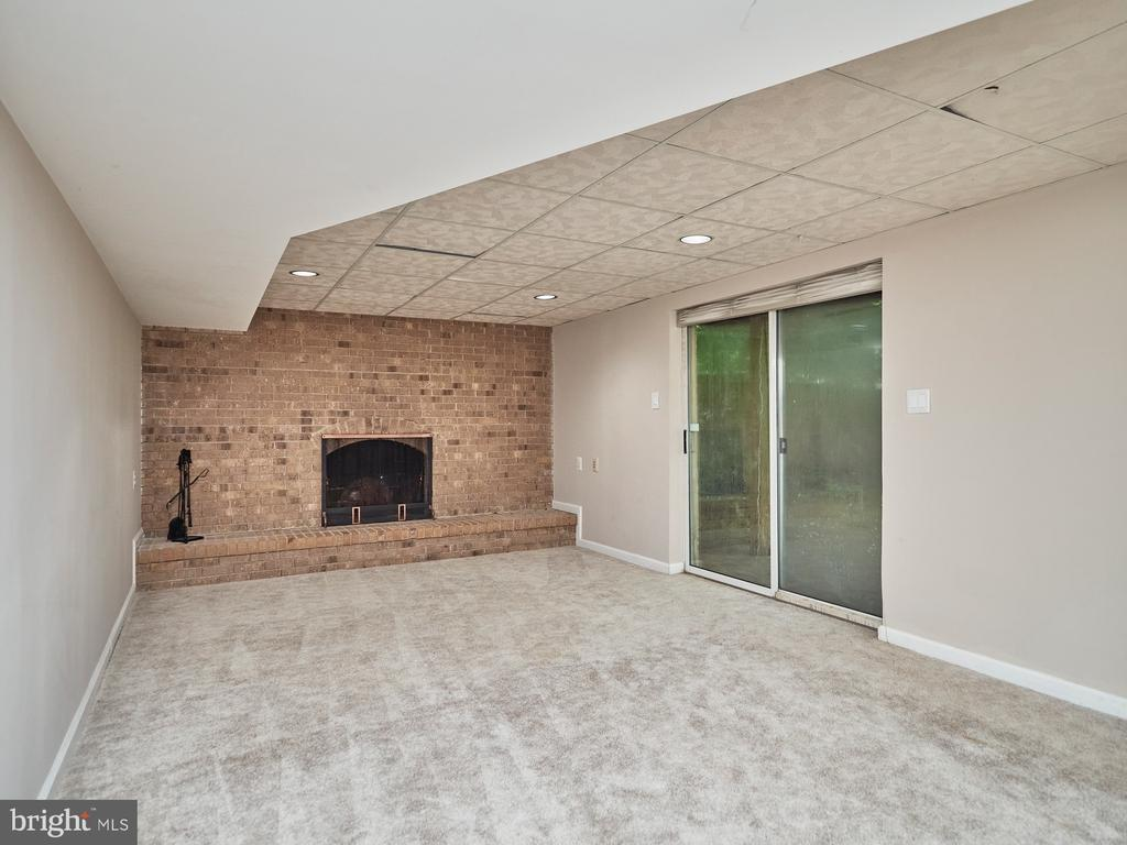 Second Fireplace w/ Brick Surround in Lower Level - 3710 KRYSIA CT, ANNANDALE