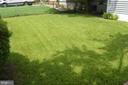 Front yard; lush green grass with no weeds - 4712 EDGEWOOD RD, COLLEGE PARK