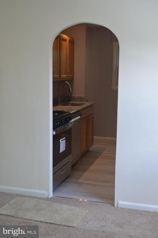 Arch doorway from living room to kitchen - 4712 EDGEWOOD RD, COLLEGE PARK