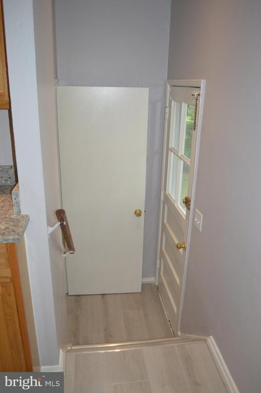 Stairwell to lower level landing - 4712 EDGEWOOD RD, COLLEGE PARK