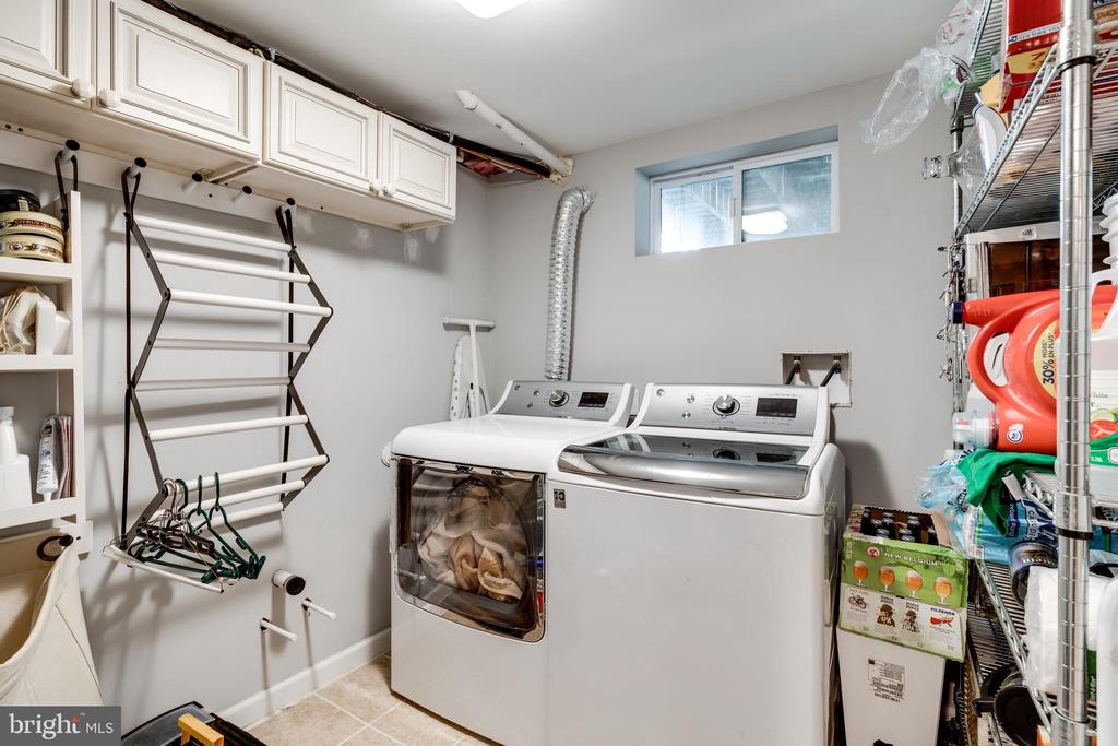 Laundry room with finished walls & storage - 224 WESMOND DR, ALEXANDRIA