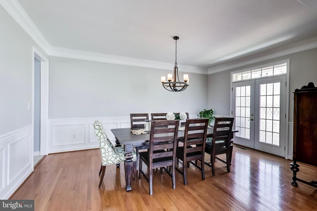 Formal dining with decorative moldings - 13016 SAINT CLAIR RD, CLARKSBURG