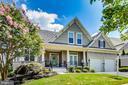 Classic exterior boasting modern amenities - 13016 SAINT CLAIR RD, CLARKSBURG