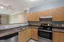 kitchen with view open to LR/DR - 3009 NICOSH CIR #4407, FALLS CHURCH