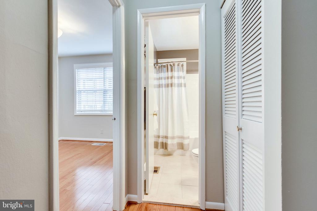 In unit washer and dryer outside bathroom - 2515-A S WALTER REED DR #A, ARLINGTON
