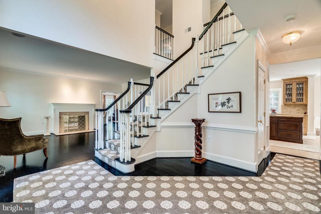 Welcoming foyer with new banister - 3812 WASHINGTON WOODS DR, ALEXANDRIA