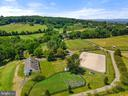 Aerial of stable & outdoor schooling area - 19200 ORCHARD MANOR LN, LEESBURG