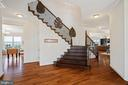 Dramatic entry with waterfall staircase - 41932 CLOVER VALLEY CT, ASHBURN