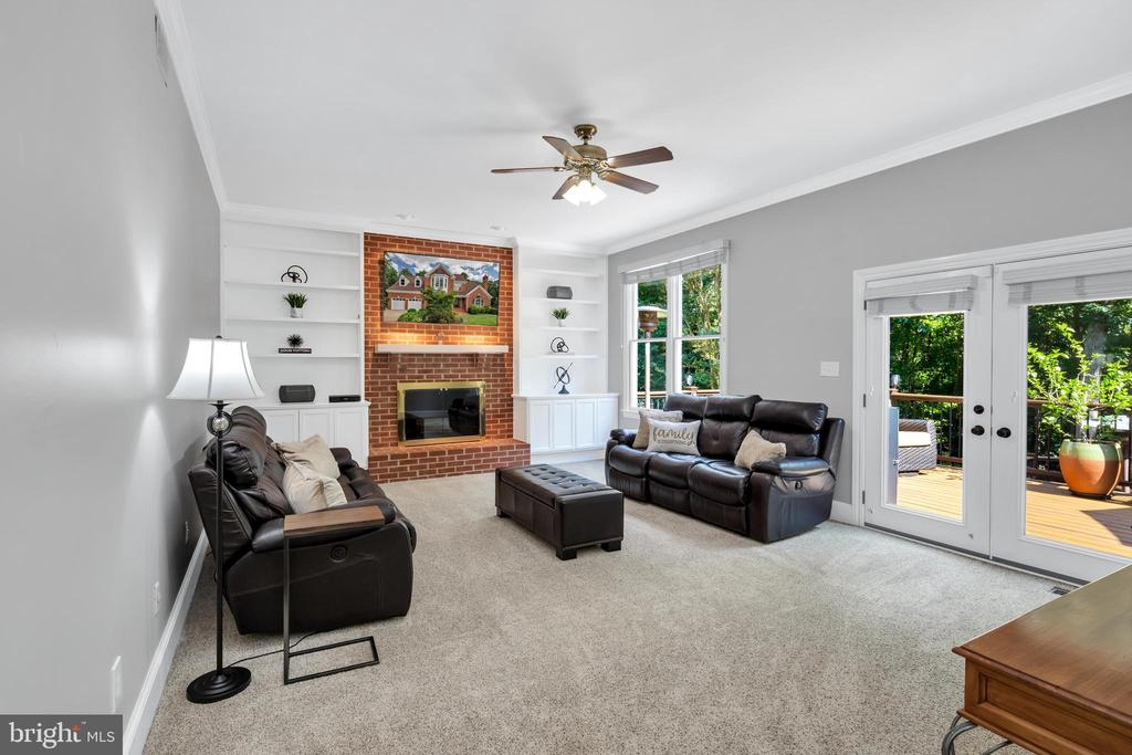Family Room with wood burning fireplace - 8119 HADDINGTON CT, FAIRFAX STATION