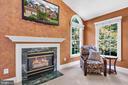 Enjoy the sitting area & gas log fireplace - 8119 HADDINGTON CT, FAIRFAX STATION
