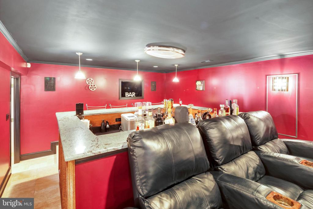 Custom oak bar in the amazing theater room - 8119 HADDINGTON CT, FAIRFAX STATION