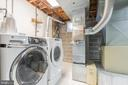 Lower laundry and storage. Washer and dryer convey - 10832 MIDDLEBORO DR, DAMASCUS