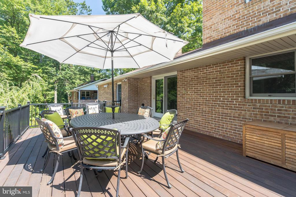 Access to the deck from the kitchen, view of woods - 10832 MIDDLEBORO DR, DAMASCUS