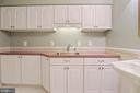 Lower level full bath with utility sink - 11308 KNIGHTS LANDING CT, LAUREL