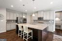 Light gray cabinets with darker island - 17429 SPRING CRESS DR, DUMFRIES