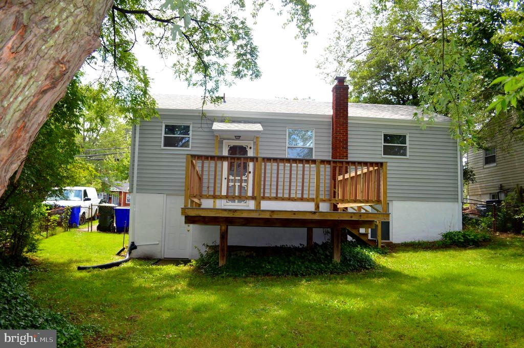 Rear view of house with deck - 4712 EDGEWOOD RD, COLLEGE PARK