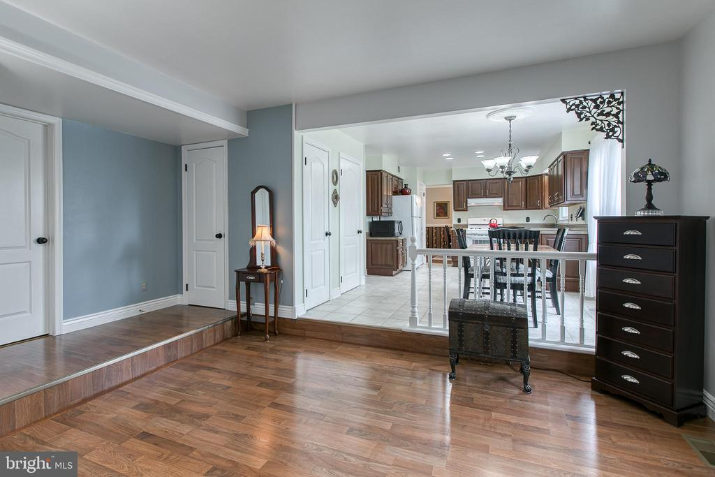 The main-level laundry is off of the family room - 10517 CEDAR CREEK DR, MANASSAS