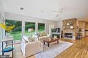 Family Room with gas fireplace overlooks side yard - 2747 N NELSON ST, ARLINGTON
