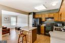 Kitchen opens to a spacious family area - 8873 OLD SCAGGSVILLE RD, LAUREL