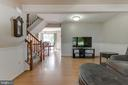 Linving room flows into dining / kitchen area - 8873 OLD SCAGGSVILLE RD, LAUREL