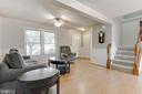 Stairway to both levels is off living room - 8873 OLD SCAGGSVILLE RD, LAUREL