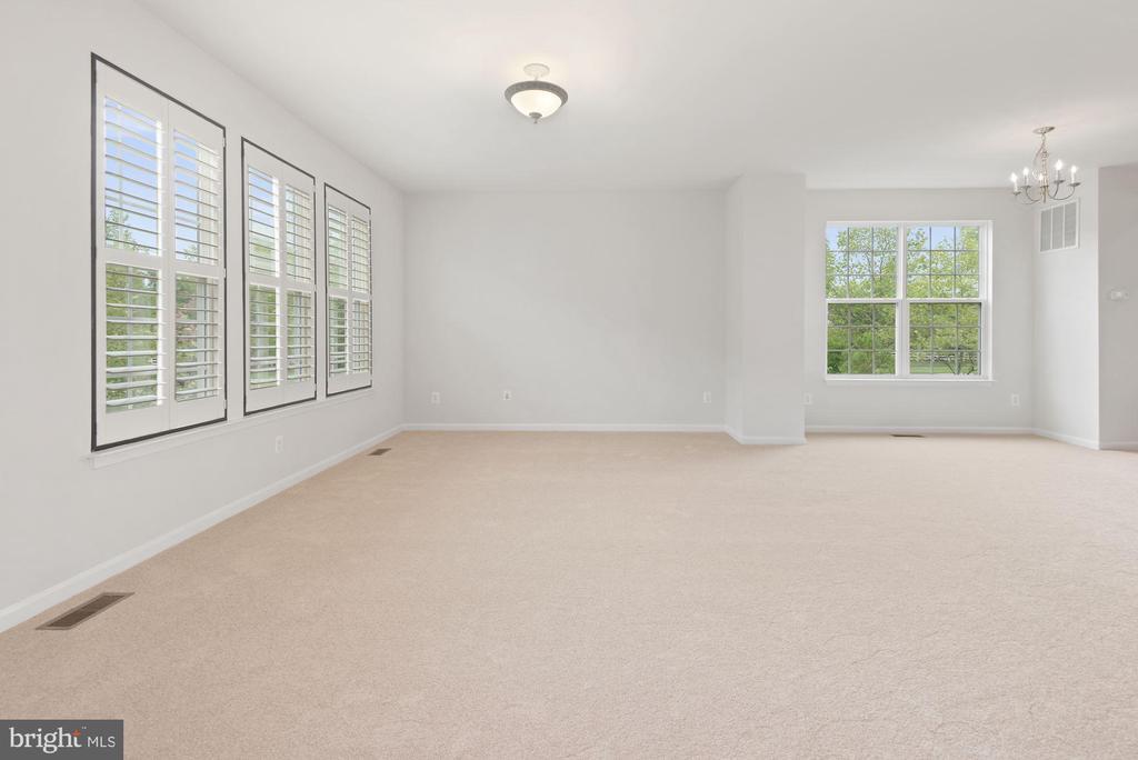 Living Room featuring Plantation Shutters - 43666 CHICACOAN CREEK SQ, LEESBURG