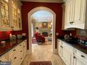 Parlor's butlers pantry to family room - 40483 GRENATA PRESERVE PL, LEESBURG