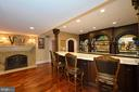 Lower level bar with corner double fireplaces - 40483 GRENATA PRESERVE PL, LEESBURG