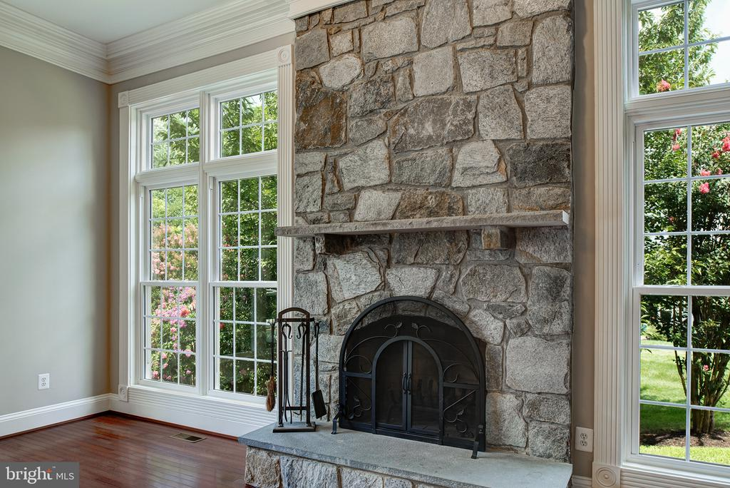 Custom Arched stone faced wood burning fireplace - 42428 HOLLY KNOLL CT, ASHBURN