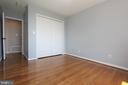 Bedroom 4 with hardwood floors and neutral paint - 5520 BOOTJACK DR, FREDERICK