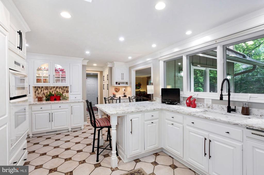 VIEW OF KITCHEN TOWARD FRONT OF HOME - 9500 WOODSTOCK CT, SILVER SPRING