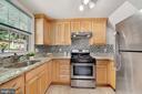 Stainless steel appliances & custom backsplash - 3707 KEMPER RD, ARLINGTON
