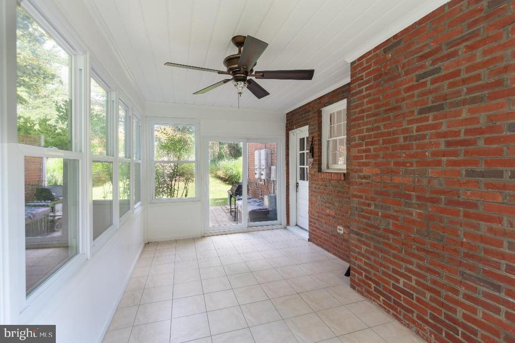 Fully enclosed side porch. - 9407 BRUCE DR, SILVER SPRING