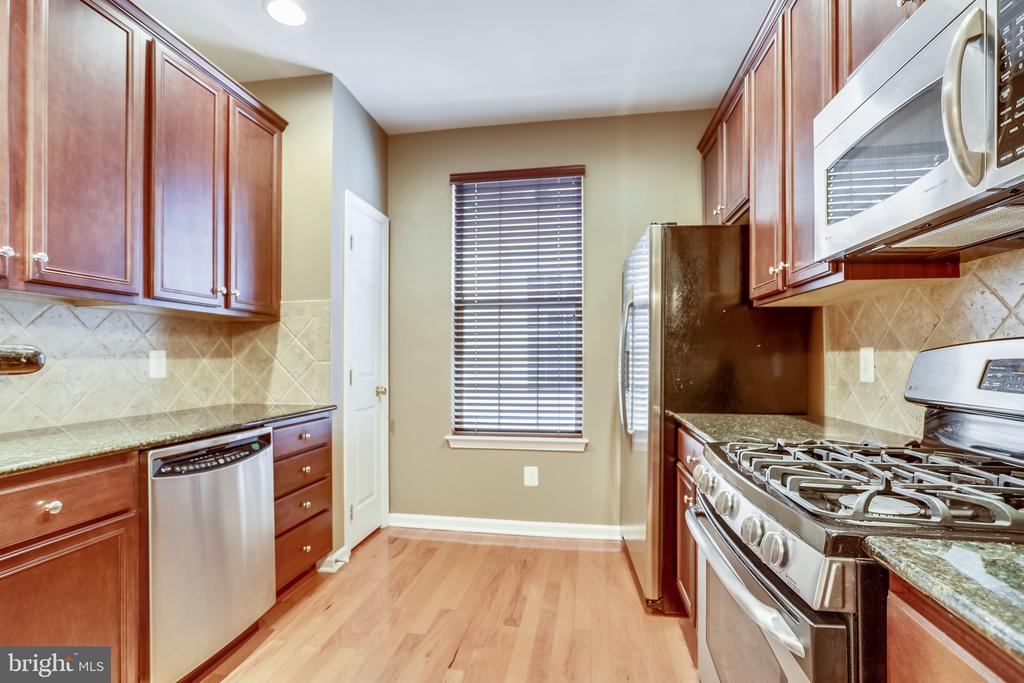 GE profile stainless appliances. - 20385 BELMONT PARK TER #112, ASHBURN