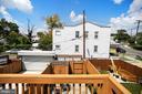 Rear balcony has view of high-end hardscape patio - 332 CHANNING ST NE, WASHINGTON