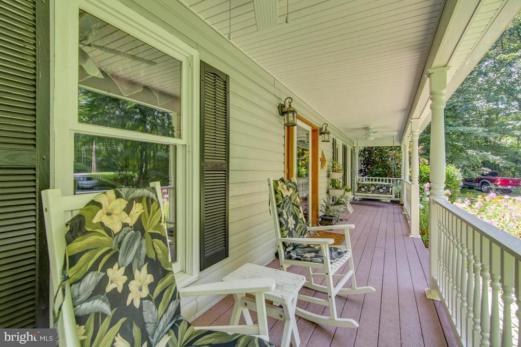 Trek deck front porch with ceiling fans and swings - 13613 BETHEL RD, MANASSAS