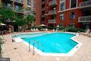 Resort-style community pool. - 1205 N GARFIELD ST #608, ARLINGTON