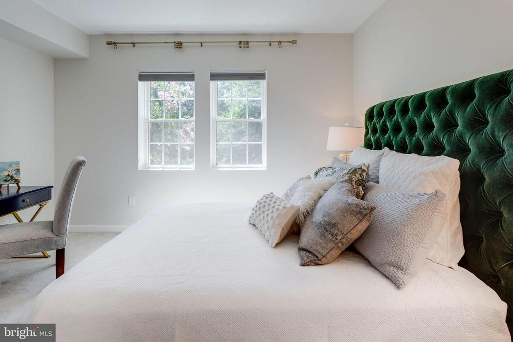View from Bath shows light-filled room... - 1741 N TROY ST #8-430, ARLINGTON