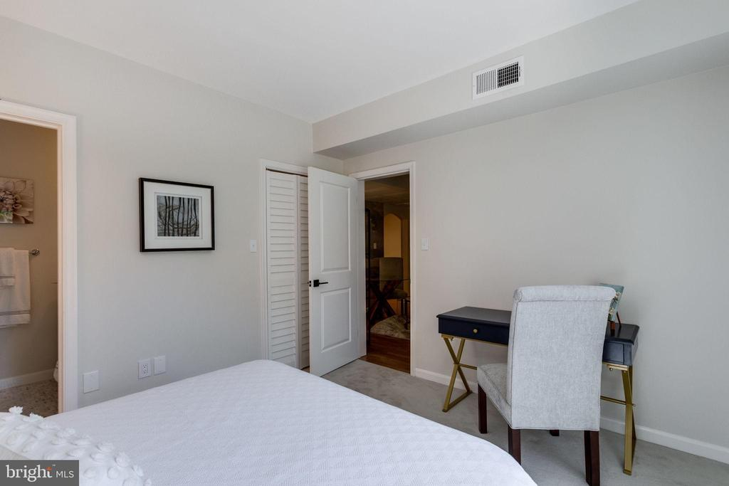 Large walk in closet located behind louvered doors - 1741 N TROY ST #8-430, ARLINGTON
