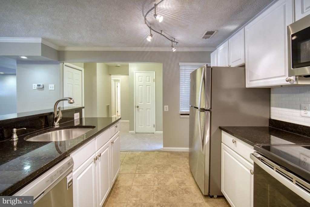 Kitchen has brand new SS appliances - 1638 WESTWIND WAY, MCLEAN